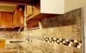 Granite kitchen with travertine tile backsplash
