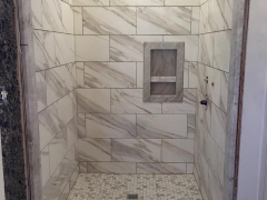 Calcutta Gold tile shower