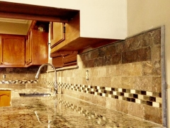 Granite kitchen with travertine tile backsplash